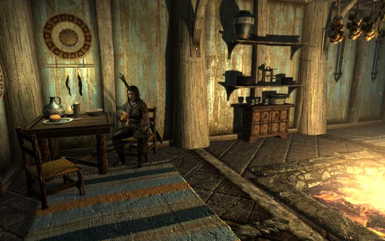 玄関脇のテーブルの椅子に腰掛けるLydia